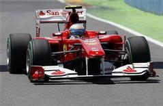<p>Piloto da Ferrari na Fórmula 1 Fernando Alonso durante segunda sessão de treino da GP da Europa em Valência. Alonso encantou a torcida da casa fazendo a volta mais rápida dos treinos livres desta sexta-feira. 25/06/2010 REUTERS/Juan Medina</p>