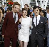 "<p>Cast members Robert Pattinson (L), Kristen Stewart (C) and Taylor Lautner pose at the premiere of ""The Twilight Saga: Eclipse"" during the Los Angeles Film Festival at Nokia theatre at L.A. Live in Los Angeles June 24, 2010. REUTERS/Mario Anzuoni</p>"