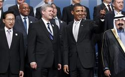 <p>U.S. President Barack Obama gestures as world leaders gather for a group photo at the G20 Summit in Toronto June 27, 2010. Pictured are: South Korean President Lee Myung-bak, Canadian Prime Minister Stephen Harper, Obama, Saudi King Abdullah, French President Nicolas Sarkozy (front row, L-R), Spanish Prime Minister Jose Luis Rodriguez Zapatero, Prime Minister Jan Peter Balkenende of the Netherlands, South African President Jacob Zuma, Russia President Dmitry Medvedev, Ethiopian Prime Minister Meles Zenawi and Turkish Prime Minister Tayyip Erdogan (back row, L-R). REUTERS/Jim Young</p>