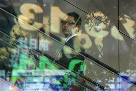 6月29日、東京外国為替市場で、ドル/円は89円を割り込み、1カ月半ぶりの安値をつけた。写真は都内の為替ボード。昨年9月撮影(2010年 ロイター/Toru Hanai)
