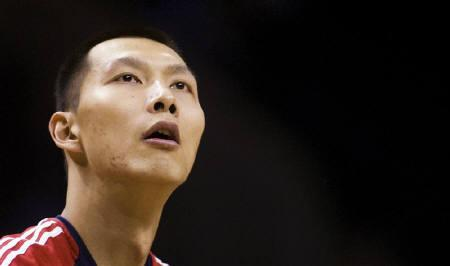 New Jersey Nets forward Yi Jianlian of China (9) warms up prior to playing the Charlotte Bobcats during an NBA basketball game in Charlotte, North Carolina February 16, 2010. REUTERS/Chris Keane