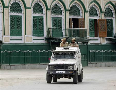 Policemen patrol the streets during a curfew in Srinagar June 30, 2010. REUTERS/Fayaz Kabli