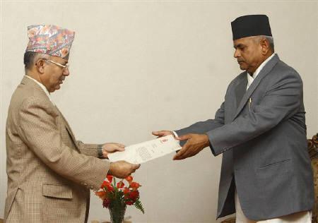 Nepal's Prime Minister Madhav Kumar Nepal (L) submits his resignation to President Ram Baran Yadav in the president's quarter in Kathmandu June 30, 2010. REUTERS/Deepa Shrestha