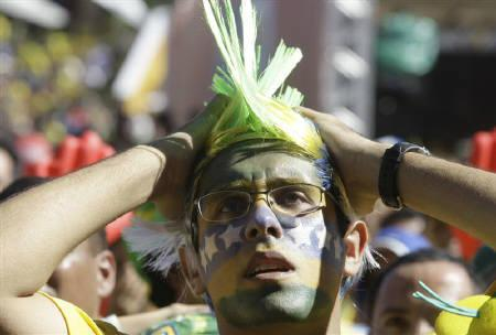 Brazilian soccer fan reacts after a public screening of the FIFA World Cup soccer match between Brazil and the Netherlands, on Copacabana beach in Rio de Janeiro July 2, 2010. REUTERS/Bruno Domingos