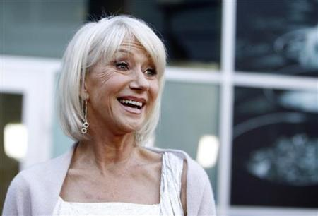 Cast member Helen Mirren smiles at the premiere of the movie ''Love Ranch'' at the Arclight theatre in Los Angeles June 23, 2010. REUTERS/Mario Anzuoni