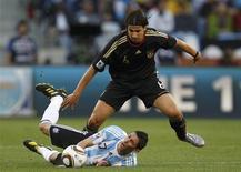<p>Meia alemão Sami Khedira durante lance da partida contra a Argentina, no sábado: jogador não participou de treinos por uma lesão na coxa. REUTERS/Kai Pfaffenbach</p>