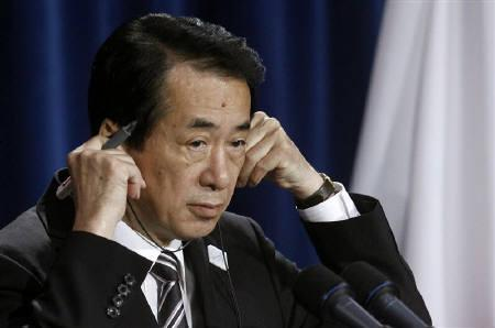 Japan's Prime Minister Naoto Kan listens to a translation during his closing news conference at the G20 Summit in Toronto June 27, 2010. REUTERS/Jim Young/Files
