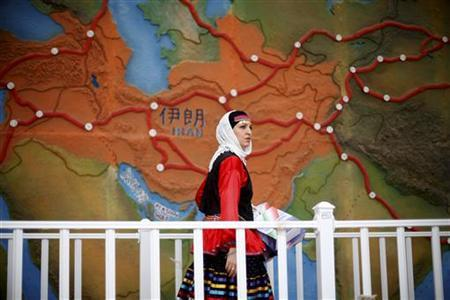 An Iranian woman wearing traditional costume walks past at the Iran Pavilion at the Shanghai World Expo on Iran's Pavilion Day, June 11, 2010. REUTERS/Aly Song