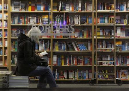 A customer is seen through the window of a Borders book store in New York in this March 16, 2010 file photo. REUTERS/Brendan McDermid