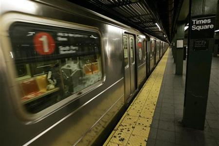 A subway train pulls into the Times Square station after service resumed in New York early December 23, 2005. REUTERS/Keith Bedford