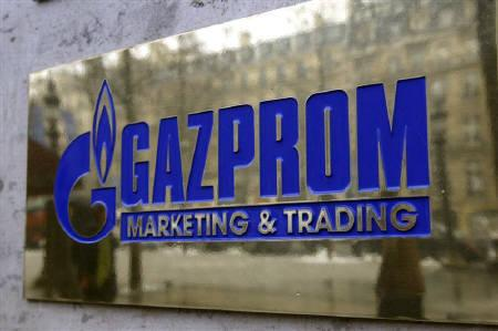 The logo of Gazprom marketing department is seen in front the office located on the Champs Elysees in Paris, January 5, 2009. REUTERS/Charles Platiau/Files