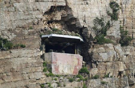 A South Korean Marine guard post is seen in a cliff on Baengnyeongdo, an island near the disputed maritime border with North Korea, northwest of Seoul, June 15, 2010. REUTERS/Truth Leem/Files