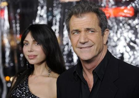 Cast member Mel Gibson (R) and Oksana Grigorieva attend the premiere of the film ''Edge of Darkness'' in Los Angeles January 26, 2010. REUTERS/Phil McCarten