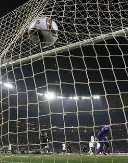 Ghana's goalkeeper Richard Kingson watches as the ball hits the back of his net after a goal by Germany's Mesut Ozil during their 2010 World Cup Group D soccer match at Soccer City stadium in Johannesburg June 23, 2010. REUTERS/Siphiwe Sibeko/Files