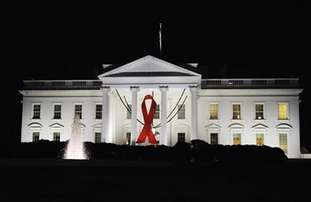 A red ribbon hangs in advance of World AIDS Day on the front of the White House in Washington, November 29, 2009. REUTERS/Jonathan Ernst