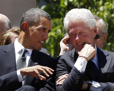 President Obama and former president Bill Clinton attend the memorial service for Senator Robert Byrd on the steps of the state capitol in Charleston, West Virginia, July 2, 2010. REUTERS/Larry Downing