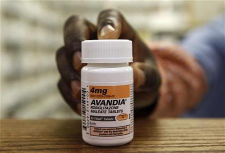 A pharmacist holds a bottle of Avandia in a store in Falls Church, Virginia July 14, 2010. GlaxoSmithKline expects to record a legal charge of $2.4 billion for the second quarter after settling the ''substantial majority'' of claims relating to its diabetes pill Avandia.REUTERS/Kevin Lamarque