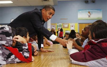 President Obama greets third and fourth grade students at Viers Mill Elementary School in Silver Spring, Maryland, October 19, 2009. REUTERS/Jason Reed