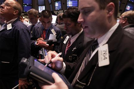 Traders work trading shares of Kohlberg Kravis Roberts & Co as the company offers it's stock on the New York Stock Exchange for the first time in New York July 15, 2010. REUTERS/Lucas Jackson