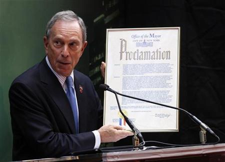 New York Mayor Michael Bloomberg holds up a certificate at the world premiere of ''The Sorcerer's Apprentice'' in New York July 6, 2010. REUTERS/Eric Thayer