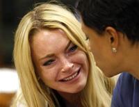 <p>Atriz Lindsay Lohan chora após ter sido condenada em 6 de julho à prisão por violar os termos da sua liberdade condicional. REUTERS/David McNew</p>