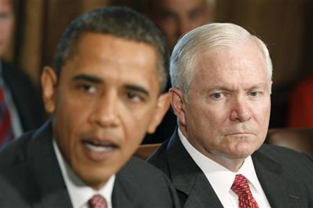 President Barack Obama speaks next to Secretary of Defense Robert Gates (R) in a cabinet meeting where President Obama commented on General McChrystal's complaints in a recent Rolling Stone magazine article, at the White House in Washington, June 22, 2010. REUTERS/Larry Downing