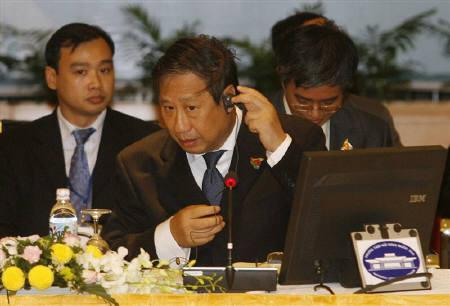 Vietnam's Foreign Minister Pham Gia Khiem (C) adjusts a headphone before the 4th meeting of the ASEAN politics and security community council in Hanoi July 19, 2010. The 42th ASEAN Foreign Ministerial meeting takes place in Hanoi from July 19 to July 23. REUTERS/Kham