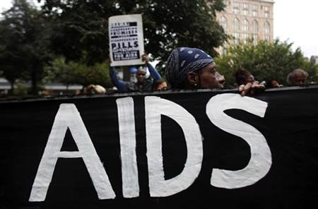 AIDS activists demonstrate carrying mock coffins near the site of the upcoming G20 Pittsburgh Summit as they protest against the policies of the world's wealthiest nations regarding AIDS research and treatment funding in Pittsburgh, Pennsylvania September 22, 2009. REUTERS/Eric Thayer