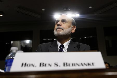 Federal Reserve Board Chairman Ben Bernanke takes his seat to testify before the Senate Banking, Housing and Urban Affairs Committee in a hearing on ''The Semiannual Monetary Policy Report to the Congress,'' on Capitol Hill, July 21, 2010. REUTERS/Molly Riley