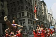 <p>A cheerleading group takes part in the annual Gay Pride Parade in New York, June 27, 2010. REUTERS/Keith Bedford</p>