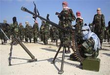 <p>Members of the hardline al Shabaab Islamist rebel group parade their weapons in Somalia's capital Mogadishu, January 1, 2010. REUTERS/Feisal Omar</p>