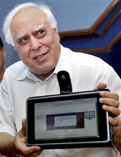 India's Human Resource Development Minister Kapil Sibal displays the low-cost computing device during its unveiling in New Delhi, July 22, 2010. REUTERS/Stringer
