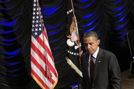President Barack Obama walks off the stage after signing the Dodd-Frank Wall Street Reform and Consumer Protection Act in Washington, July 21, 2010. REUTERS/Jim Young
