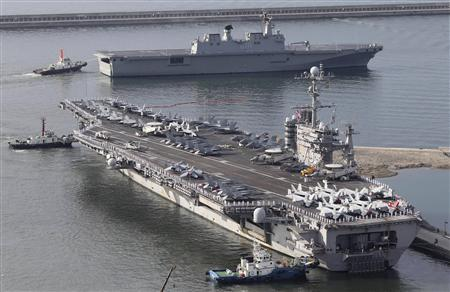 The U.S. nuclear-powered aircraft carrier USS George Washington (bottom) and the South Korean Navy's Landing Platform Helicopter ship Dokdo leave for a U.S.-South Korea joint naval and air exercise at a South Korean naval port in Busan, about 420 km (262 miles) southeast of Seoul, July 25, 2010. REUTERS/Jo Jung-Ho/Yonhap
