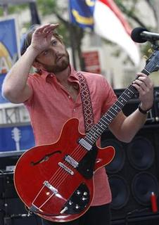 Caleb Followill, lead singer for ''Kings of Leon,'' appears with his band on NBC's 'Today' show in New York, July 31, 2009. REUTERS/Brendan McDermid