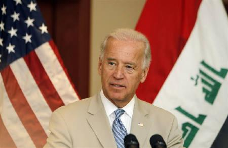 U.S. Vice President Joe Biden speaks at the U.S. embassy in Baghdad July 4, 2010. REUTERS/Thaier al-Sudani/Files