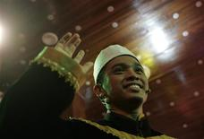 "<p>""Ultimate Young Imam"" Asyraf celebrates after winning the Malaysian reality TV competition to find the country's best young Imam during its live telecast in Kuala Lumpur July 30, 2010. REUTERS/Samsul Said</p>"