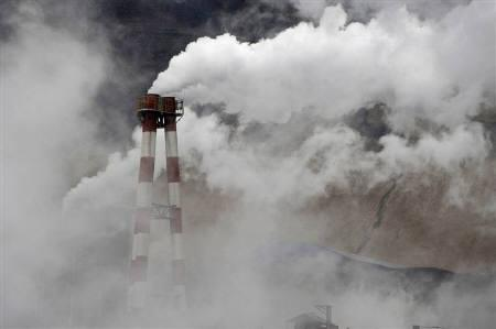Smoke rise from chimneys at a steel and iron plant in Zhongyang county, Shanxi province November 10, 2009. Beijing. REUTERS/Stringer/Files