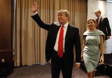 Donald Trump waves to journalists and employees gathered at a ribbon cutting at the Trump Soho Hotel in New York, April 9, 2010. REUTERS/Jessica Rinaldi