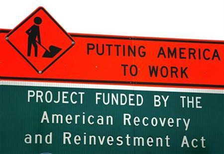 A sign announces a section of road work funded by the American Recovery and Reinvestment Act economic stimulus plan in the Denver area, September 10, 2009. REUTERS/Rick Wilking
