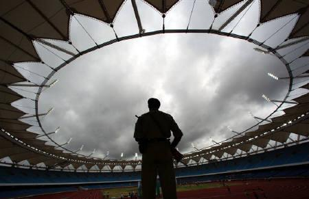 A paramilitary soldier stands guard inside the Jawaharlal Nehru Stadium constructed for the 2010 Commonwealth Games during its inauguration ceremony in New Delhi July 27, 2010. REUTERS/Adnan Abidi/Files