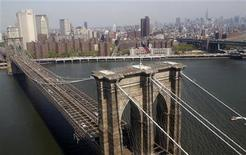 <p>The Brooklyn Bridge and lower Manhattan is seen from a helicopter in New York City, April 22, 2010. REUTERS/Jim Young</p>