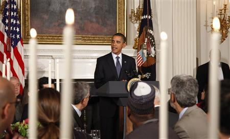 U.S. President Barack Obama delivers remarks during the Iftar dinner in the State Dining Room of the White House in Washington August 13, 2010. The Iftar dinner celebrates the evening breaking of fast during the Muslim holy month of Ramadan. REUTERS/Jason Reed