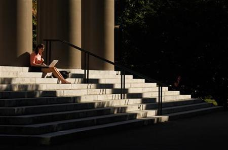 A student uses her laptop computer on the steps to Memorial Church at Harvard University in Cambridge, Massachusetts in this September 21, 2009 file photo. REUTERS/Brian Snyder