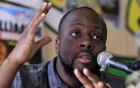 Haitian singer Wyclef Jean attends a news conference before his concert at the Antilliaanse Feesten music festival in Hoogstraten, August 13, 2010.   REUTERS/Sebastien Pirlet/Files