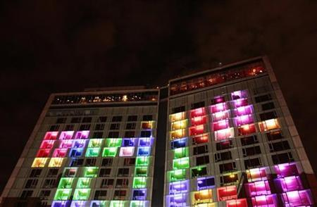 Lights and dancers can be seen in the windows of The Standard hotel during a light show for the company's ''Kaleidoscopic Fashion Spectacular'' in New York August 18, 2010. REUTERS/Lucas Jackson