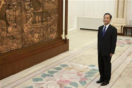 Chinese Premier Wen Jiabao stands waiting to greet visiting New Zealand Prime Minister John Key before their meeting at the Great Hall of the People in Beijing in this July 7, 2010 file photo. REUTERS/Alexander F. Yuan/Pool