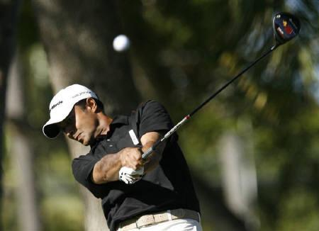 Arjun Atwal of India drives off the second tee during the third round of the Sony Open golf tournament in Honolulu, Hawaii on January 17, 2009. REUTERS/Hugh Gentry/Files