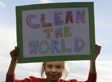 A girl holds a sign during a protest to demand for climate action in Sydney June 13, 2009.  REUTERS/Daniel Munoz/Files