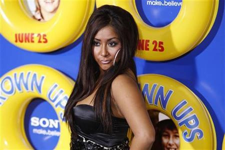 Nicole ''Snooki'' Polizzi of reality television program ''Jersey Shore'' arrives as a guest for the premiere of the film ''Grown Ups'' in New York June 23, 2010.